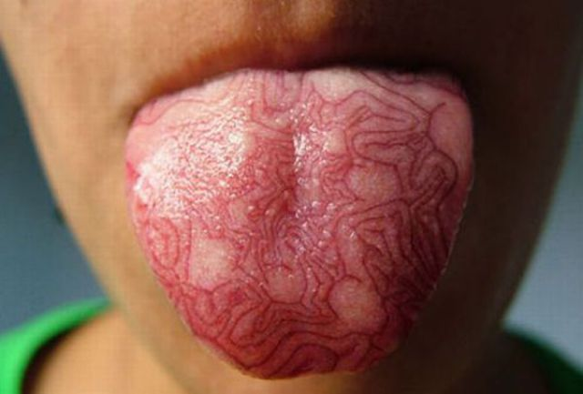 weird tongue tattoo